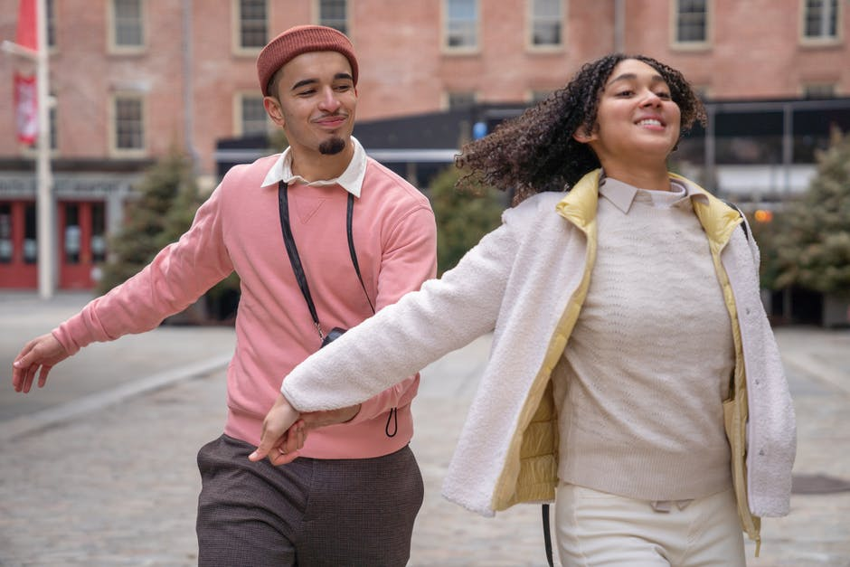 A man and a woman walking down a street